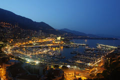 Monaco and his port at night. Picture taken in the principauté de monaco at the evening. it shows the city and the boat station. who does not know this royalty free stock photo