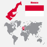 Monaco map on a world map with flag and map pointer. Vector illustration Royalty Free Stock Photo