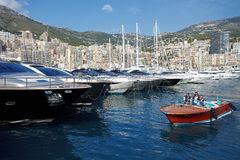 Monaco, Monte-Carlo, 29.05.2008: Port Hercule. View from water, luxury yachts in harbor of Monaco, Etats-Uni, Piscine, Hirondelle, riva boat Royalty Free Stock Photography