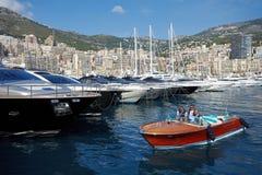 Monaco, Monte-Carlo, 29.05.2008: Port Hercule. View from water, luxury yachts in harbor of Monaco, Etats-Uni, Piscine, Hirondelle, riva boat, MYS, Monaco Yacht Stock Images