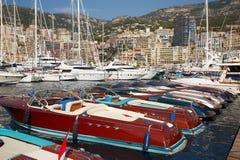 Monaco, Monte-Carlo, 25.09.2008: Yacht Show, Port Hercule. Luxury yachts in harbor of Monaco, Etats-Uni, Piscine, Hirondelle, riva boats parking Stock Images