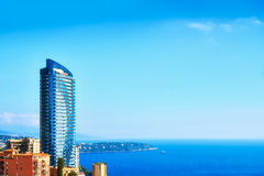 Monaco`s Tour Odeon and Cap Martin. High rise building in Monte Carlo and the mediterranean sea Royalty Free Stock Images