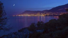 Monaco under the Moonlight. Monaco viewed from Roquebrune by night Royalty Free Stock Images