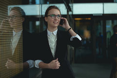 Monan on smart phone - young business woman in office. Stock Images