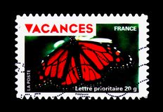 Monarch Butterfly (Danaus plexippus), Holidays serie, circa 2009. MOSCOW, RUSSIA - MARCH 18, 2018: A stamp printed in France shows Monarch Butterfly &# Stock Photography