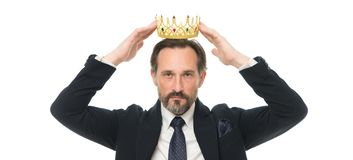 Monarchy family traditions. Man nature bearded guy in suit hold golden crown symbol of monarchy. Direct line to throne. Enormous privilege. Become king stock photo