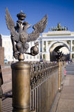 Monarchy symbol scepter and power. Monarchy symbol on a fencing on Palace Square Stock Photography