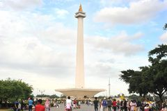 Monas. Jakarta,Indonesia - March 3, 2011: people at National Monument l (Monas) is a 433 ft (132 meter) tower in the center of Merdeka Square, Central Jakarta royalty free stock photo