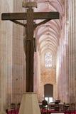 Monasterio de Batalha. Crucifijo y altar Fotografía de archivo libre de regalías