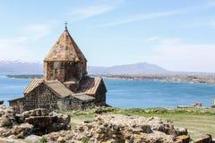 Monasterio de Sevanavank - apóstoles santos y la virgen bendecida, lago Sevan en el fondo, Armenia Fotografía de archivo libre de regalías