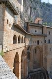 Monastero S. Benedetto in Subiaco, Italy. The imposing monastery is built directly into the mountains near Subiaco, Italy. Photo taken April 2015 Royalty Free Stock Images