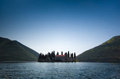 Monastery. Natural island in Kotor Bay in Montenegro with a Catholic monastery of St.George. Bright sunny day and blue sky Royalty Free Stock Photo