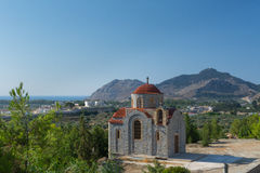 Monastery Afantou Rhodes. The Monastery Afantou on Rhodes Island. In the background on the Mountain is the famous Tsambika Monastery stock photo