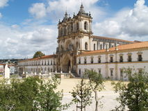 Monastery at Alcobaca. Portugal set against a blue sky with clouds stock images