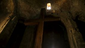 Monastery architecture, religious cross inside monk cell, conversation with God stock video