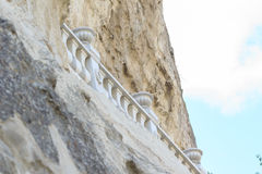 Monastery balustrade in rock. Royalty Free Stock Image