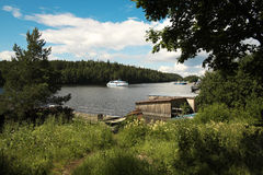 Monastery Bay. Port. Island Valaam. Monastery Bay. Port. Passenger ship approaches the dock Royalty Free Stock Images