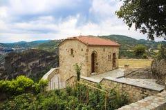 Monastery build on high rocks on Athos mountain Stock Image