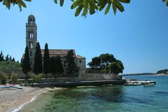Monastery/church. Monastery church surrounded by the sea on island of Hvar, Croatia Royalty Free Stock Images