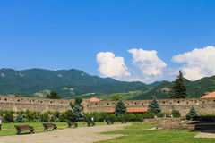 Monastery courtyard with benches Royalty Free Stock Photo