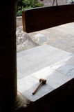 Monastery courtyard with wooden hammer Royalty Free Stock Image