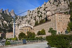 Monastery with crane and mountains royalty free stock images