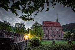 Monastery at dawn black forest night time stock photos