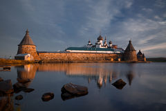 Monastery in early morning. View on Solovetsky Monastery with Holy Lake on sunrise royalty free stock images
