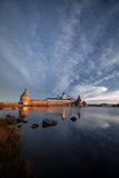 Monastery in early morning. View on Solovetsky Monastery with Holy Lake on sunrise royalty free stock photo