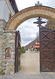 Monastery entrance door. Entrance door to monastery Kumanica, Serbia, with crosses and mosaic of the patron saint Royalty Free Stock Photos