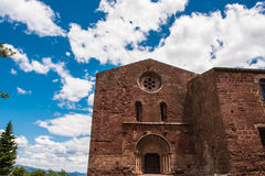 Monastery Escornalbou in Spain, Tarragona, Catalunya, main bildi. Ng, blue sky background Royalty Free Stock Photo