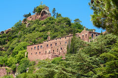 Monastery Escornalbou in Spain, Tarragona on the mountain with b. Old monastery Escornalbou in Spain, Tarragona on the mountain with blue sky Stock Photo