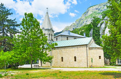 The monastery in forest Stock Images