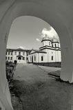 Orthodox church. Comana Monastery - Giurgiu, landmark attraction in Romania. Orthodox church. Comana Monastery, seen from the arch gate - Giurgiu, landmark stock photo