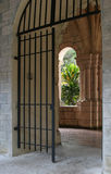 Monastery Gate. Looking through a gate and window at a monastery royalty free stock images