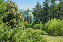 Monastery on hill in forest, Kyiv, Ukraine Stock Photo
