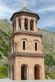 Monastery of the Holy Archangels Michael and Gabriel in Georgia. Bell-tower of monastery of the Holy Archangels Michael and Gabriel in the Daryal gorge in Royalty Free Stock Photo