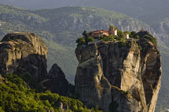 The monastery of Holy Trinity - Meteora, Greece. Estern Orthodox monastey bulit on natural sandstone rock pillar Royalty Free Stock Images
