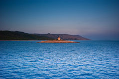 Monastery on island in Adriatic sea. In sunset light Stock Images