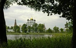 Monastery on the lake. Iosipho-Volotski monastery of 15 century in Russia. Summer cloudy day royalty free stock photography
