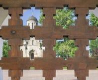 Monastery through lattice gates Royalty Free Stock Photos