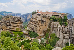 Monastery from Meteora-Greece with large green garden between tall and brown rocks Stock Photography