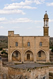 Monastery at Midyat, Mardin-Turkey. Monastery between traditional stone houses at Midyat, Mardin-Turkey Royalty Free Stock Image