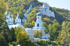 Monastery on Mt. An ancient monastery on the hill on the bank of a wide river Stock Photo
