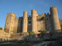 Monastery of Obidos, Portugal. In sunset light Stock Images
