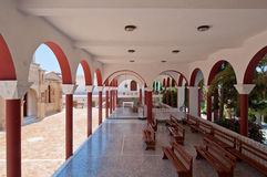 Monastery of Panagia Kalyviani arched courtyard on July 25,2014 on the Crete island, Greece. The Monastery Royalty Free Stock Images