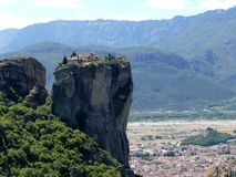 Monastery perched high up on the rocks in Meteora, Greece seen from the side Stock Image