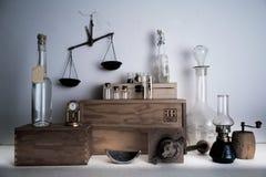 Monastery pharmacy. bottles, jars, scales, a kerosene lamp on wooden shelves Stock Photo