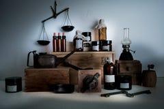 Monastery pharmacy. bottles, jars, scales, a kerosene lamp on wooden shelves Stock Photography