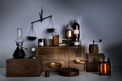 Monastery pharmacy. bottles, jars, scales, a kerosene lamp on wooden shelves Royalty Free Stock Images